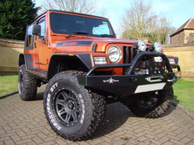 Jeep Wrangler 4.0 Grizzly 2dr Soft Top Convertible Petrol OrangeJeep Wrangler 4.0 Grizzly 2dr Soft Top Convertible Petrol Orange at Claridges Cars Leighton Buzzard
