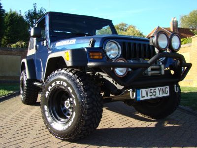 Jeep Wrangler 4.0 Sport 2dr 6 Speed Soft Top Convertible Petrol BlueJeep Wrangler 4.0 Sport 2dr 6 Speed Soft Top Convertible Petrol Blue at Claridges Cars Leighton Buzzard